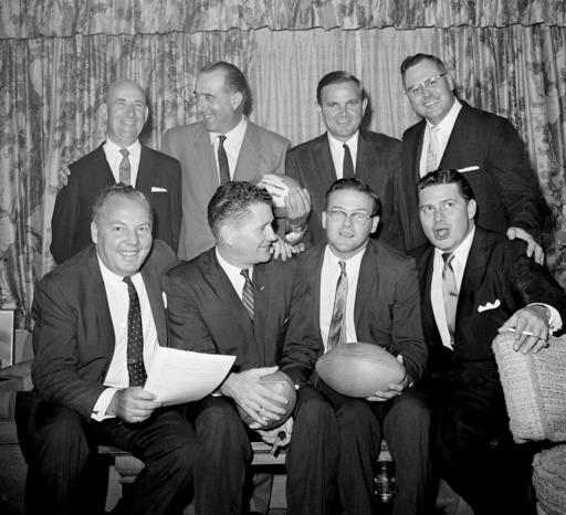FILE - In this Aug. 25, 1960, file photo, American Football League owners meet at the offices of Harry Wismer, president of the New York Titans, in New York. Left to right, front: Harry Wismer, New York Titans; Joe Foss, of the AFC; Lamar Hunt, Dallas and Bud Adams, Houston. Rear from left are: Bill Sullivan, Boston; Chet Soda, Oakland; Ralph Wilson, Buffalo and Bill Howsam, Denver. The AFL launched in 1960. (AP Photo/Marty Lederhandler, File)