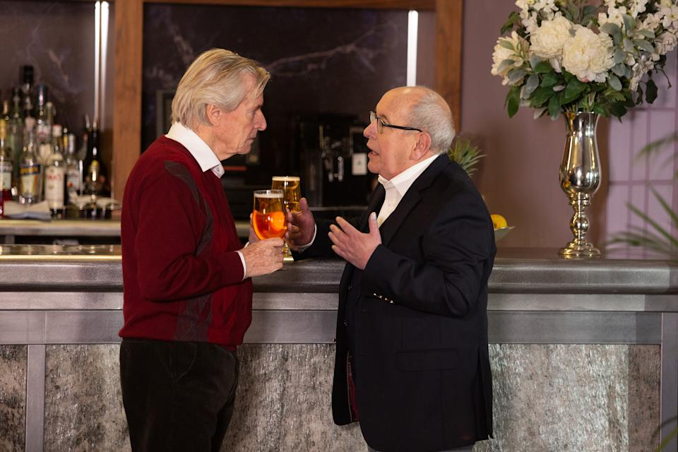 Having sabotaged Ken Barlow's [WILLIAM ROACHE] talk and suggesting they head to the bar, Norris Cole [MALCOLM HEBDEN] reveals that he and Freda moved into Stillwaters several weeks ago. Making sure Freda can't read his lips, Norris admits to Ken that he can't stand Stillwaters and needs his help to escape.  Ken's shocked. (ITV Plc)