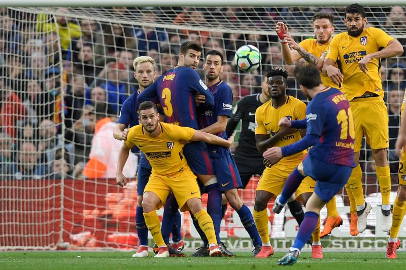Lionel Messi bent a free kick over the Atletico Madrid wall to send  Barcelona eight points clear in La Liga. (Getty) 8549a6d4a34