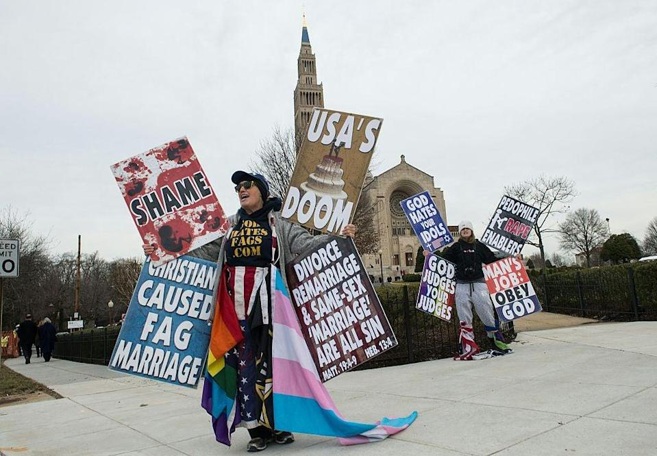 Picture: Members of the Westboro Baptist Church demonstrate outside the Basilica of the National Shrine of the Immaculate Conception before the funeral service for Justice Antonin Scalia (NICHOLAS KAMM/AFP/Getty Images)