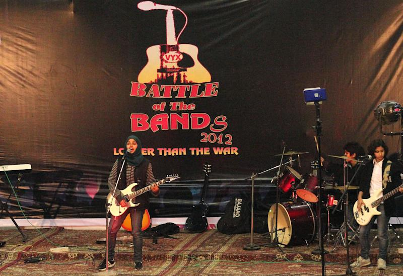 "In this Sunday, Dec. 23, 2012 photo, members of Indian-controlled Kashmir's first all-girl rock band Pragaash, or First Light, perform at the annual 'Battle of the Bands' in Srinagar, India. The band has decided to disband after only one concert because of threats its three teenaged members received on social media and harsh criticism from a top Muslim cleric and separatists, who criticized it as ""Western-style cultural waywardness."" The fate of Pragaash highlights the simmering tension between modernity and tradition in Muslim-majority Kashmir, where an armed uprising against Indian rule and a relentless crackdown by government forces have killed over 68,000 people since 1989. (AP Photo)"