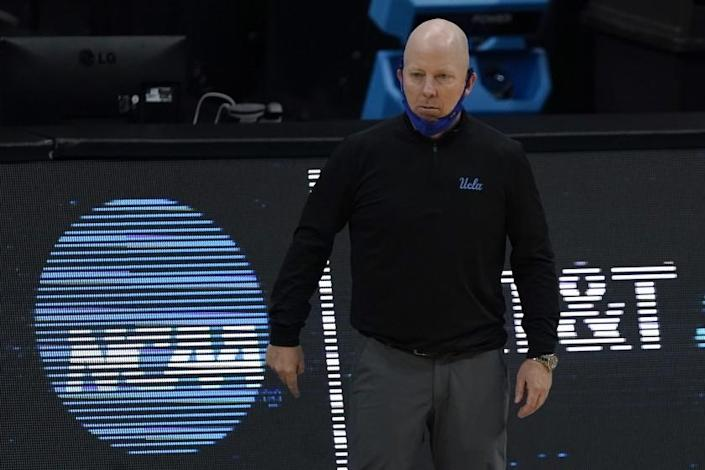 UCLA head coach Mick Cronin watches from the bench during the first half of a men's Final Four NCAA college basketball tournament semifinal game against Gonzaga, Saturday, April 3, 2021, at Lucas Oil Stadium in Indianapolis. (AP Photo/Michael Conroy)