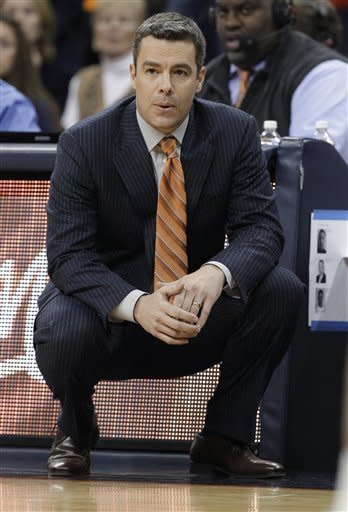 Virginia coach Tony Bennett watches his team during the first half of an NCAA college basketball game in Charlottesville, Va., Thursday, Feb. 28, 2013. (AP Photo/Steve Helber)