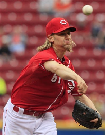 Cincinnati Reds starting pitcher Bronson Arroyo throws against the Washington Nationals in the first inning of a baseball game on Sunday, May 13, 2012, in Cincinnati. (AP Photo/Al Behrman)