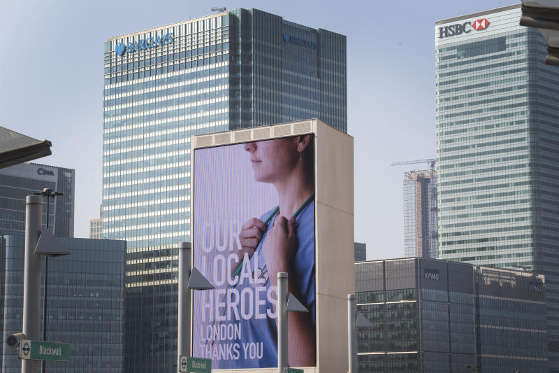 Information screens saluting local heroes on a main road passing Canary Wharf in east London as the UK continues in lockdown to help curb the spread of the coronavirus. (Photo by Victoria Jones/PA Images via Getty Images)