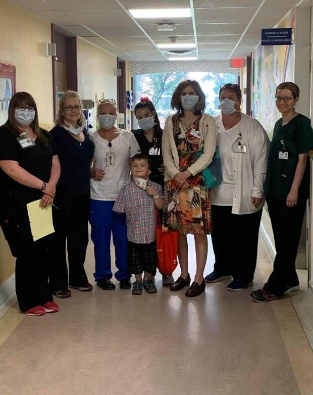 Some of the hospital staff who helped care for Nathan gather to say goodbye to him on his last day at the Moncton Hospital.