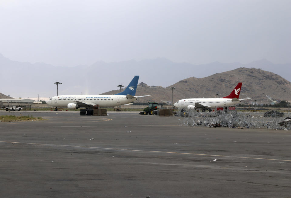 Aircraft are parked on the tarmac of the Hamid Karzai International Airport after the U.S. military's withdrawal, in Kabul, Afghanistan, Tuesday, Aug. 31, 2021. The Taliban were in full control of Kabul's airport on Tuesday, after the last U.S. plane left its runway, marking the end of America's longest war. (AP Photo/Khwaja Tawfiq Sediqi)