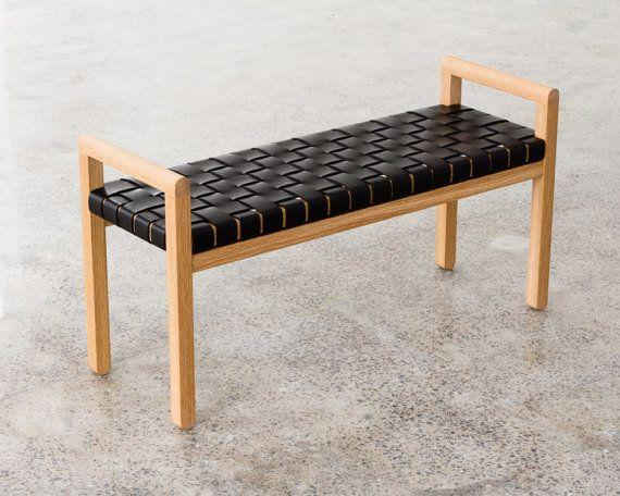 "This bench combines a minimalist oak frame with rich woven straps of leather. The bench can easily work for an entryway, bedroom, or even pulled up to the kitchen table. Get it on <a href=""https://www.etsy.com/listing/496673374/elegant-modern-wood-framed-bench-with"" target=""_blank"">Etsy</a>."