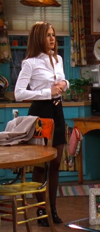 Rachel wearing a button up, a mini skirt, tights and cute shoes