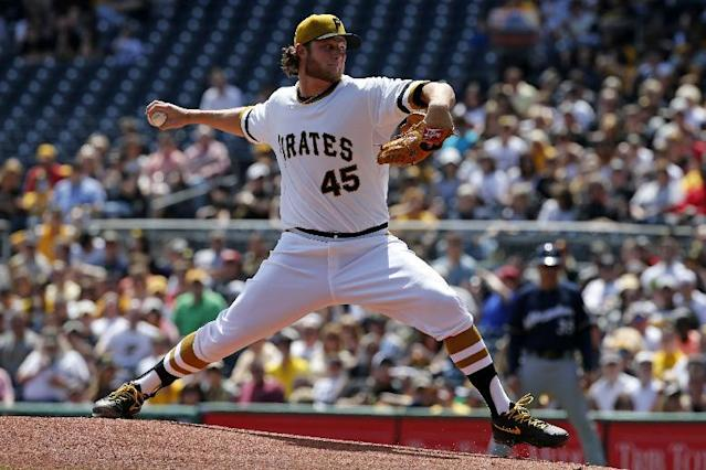 Pittsburgh Pirates starting pitcher Gerrit Cole delivers during the first inning of a baseball game against the Milwaukee Brewers in Pittsburgh, Sunday, April 20, 2014. (AP Photo/Gene J. Puskar)