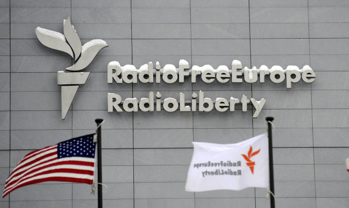 FILE - In this Friday, Jan. 15, 2010 file photo, the headquarters of Radio Free Europe/Radio Liberty (RFE/RL) is seen with the United States flag in the foreground, in Prague. Russian court bailiffs have shown up at U.S.-funded Radio Free Europe/Radio Liberty's Moscow Bureau to notify it about the launch of enforcement proceedings over unpaid fines. RFE/RL on Friday, May 14, 2021 denounced the move as a serious escalation in the Russian government's campaign to drive it out of the country. (Michal Kamaryt/CTK via AP, file)