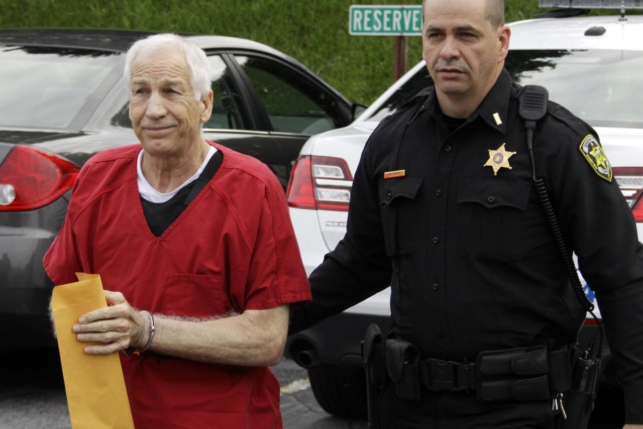 Former Penn State University assistant football coach Jerry Sandusky, left, arrives for sentencing on child sex abuse charges at the Centre County Courthouse in Bellefonte, Pa., Tuesday, Oct. 9, 2012. Tuesday, Oct. 9, 2012. Sandusky was convicted of sexually abusing 10 boys in a scandal that rocked the university and brought down Hall of Fame coach Joe Paterno. (AP Photo/Gene J. Puskar)
