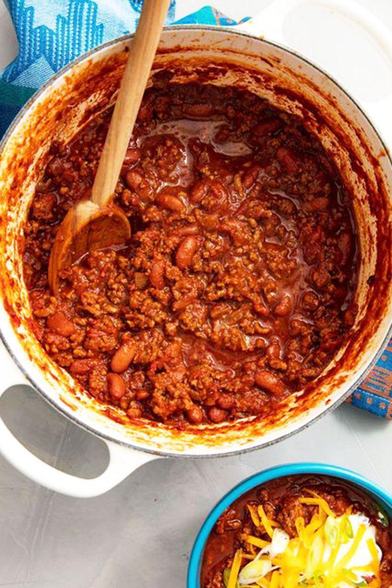 """<p>This is a chilli recipe that you can make on a weeknight in under an hour. Lots of other recipes call for simmering for at least an hour, sometimes even more! The reality of that is tough, so we've perfected this chilli to be done in just 40 minutes.</p><p>Get the <a href=""""https://www.delish.com/uk/cooking/recipes/a28886316/best-homemade-chilli-recipe/"""" rel=""""nofollow noopener"""" target=""""_blank"""" data-ylk=""""slk:Chilli Con Carne"""" class=""""link rapid-noclick-resp"""">Chilli Con Carne</a> recipe.</p>"""