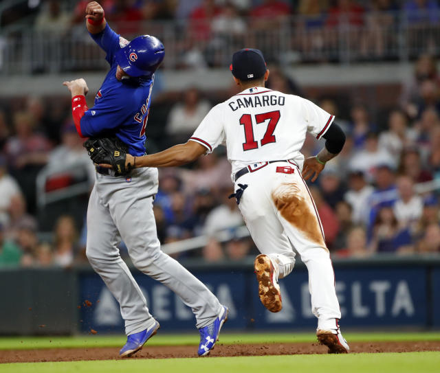 Chicago Cubs' Willson Contreras (40) is tagged out by Atlanta Braves shortstop Johan Camargo (17) after being caught in a rundown between first and second on a Kyle Schwarber ground ball during the sixth inning of a baseball game Wednesday, May 16, 2018, in Atlanta. (AP Photo/John Bazemore)
