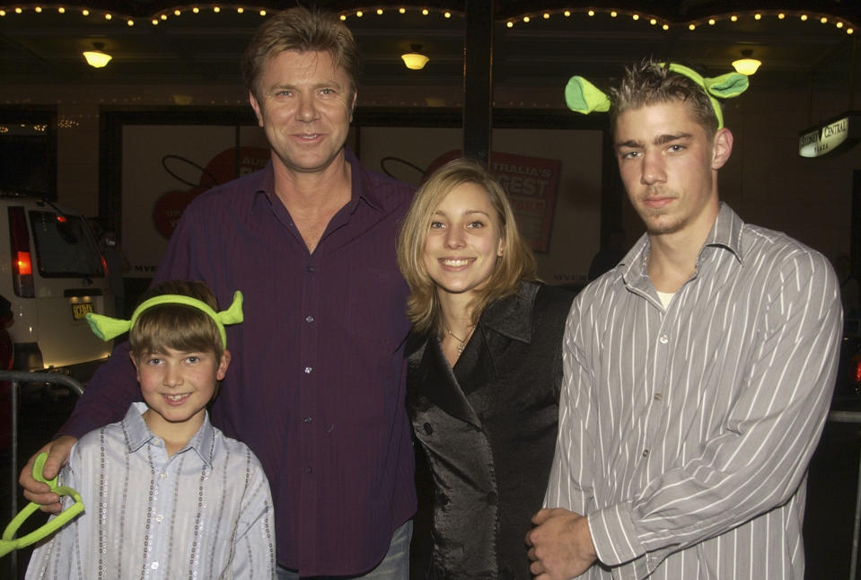 """SYDNEY, AUSTRALIA - JUNE 9:  Television personality Richard Wilkins and his children Nick, Miranda and Christian Wilkins (L-R) attend the """"Shrek2"""" Premiere at the State Theatre June 9, 2004 in Sydney, Australia. (Photo by Patrick Riviere/Getty Images)"""