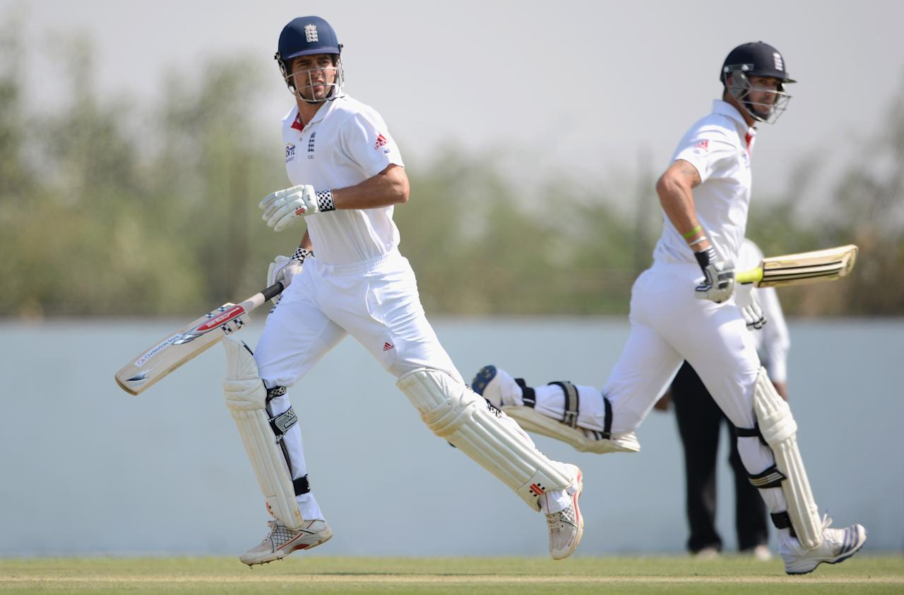 AHMEDABAD, INDIA - NOVEMBER 11:  England captain Alastair Cook and Kevin Pietersen score runs during day four of the tour match between England and Haryana at Sardar Patel Stadium ground B on November 11, 2012 in Ahmedabad, India.  (Photo by Gareth Copley/Getty Images)
