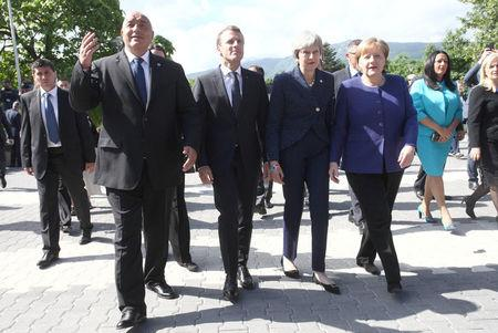Bulgaria's Prime Minister Boyko Borissov, France's President Emmanuel Macron, British Prime Minister Theresa May and Germany's Chancellor Angela Merkel walk during the EU-Western Balkans Summit in Sofia