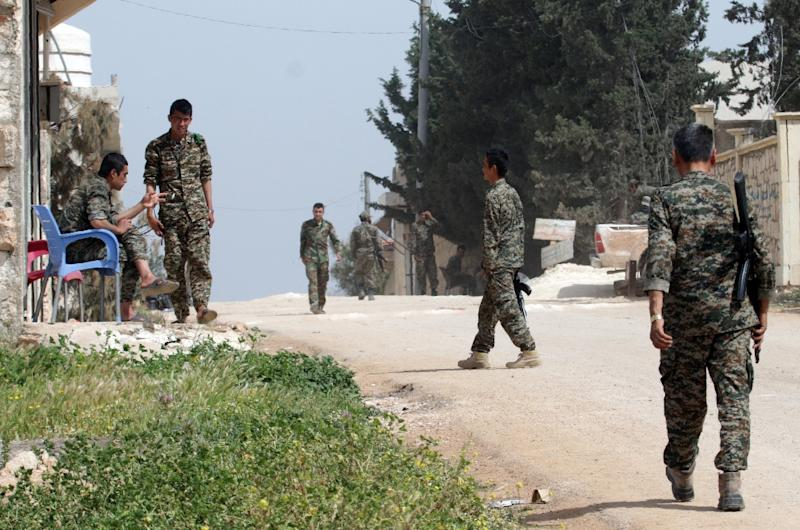 Syrian government forces patrol the town of Khan Tuman, south of the city of Aleppo in northern Syria, on April 11, 2016 (AFP Photo/George Ourfalian)