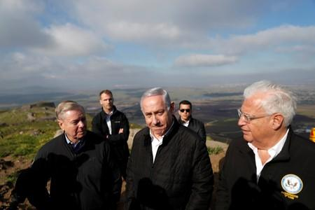 FILE PHOTO: Israeli Prime Minister Benjamin Netanyahu, U.S. Republican Senator Lindsey Graham and U.S. Ambassador to Israel David Friedman visit the border line between Israel and Syria at the Israeli-occupied Golan Heights