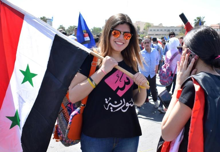 Syrians rally in Damascus' Umayyad square on April 16, 2018 in support of President Bashar al-Assad following Western air strikes against the regime over an alleged chemical attack