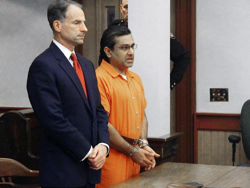 Ali Salim, right, apologizes for the death of Deanna Ballman with his attorney, Sam Shamansky, left, Friday, Dec. 20, 2013, in Delaware, Ohio. Salim, an ex-Ohio doctor was sentenced to 36 years in prison Friday after pleading guilty to causing the death of an expectant mom forced to turn to prostitution to support herself and her two young children. (AP Photo/Andrew Welsh-Huggins)