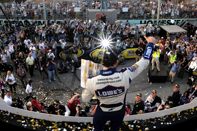 Jimmie Johnson, driver of the #48 Lowe's Chevrolet, celebrates by after finishing in second place in the Ford 400 to clinch his fifth consecutive NASCAR Sprint Cup championship at Homestead-Miami Speedway on November 21, 2010 in Homestead, Florida. (Photo by Rusty Jarrett/Getty Images for NASCAR)