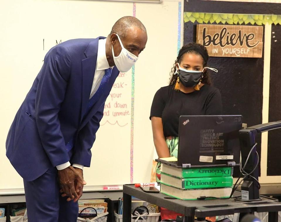 Broward Schools Superintendent Robert Runcie leans into teacher Skyler Billingsley's laptop to say hello to her students at Nova Blanche Forman Elementary School during the first day of online learning Wednesday, August 19, 2020. All Broward County public schools are teaching classes remotely because of COVID-19.