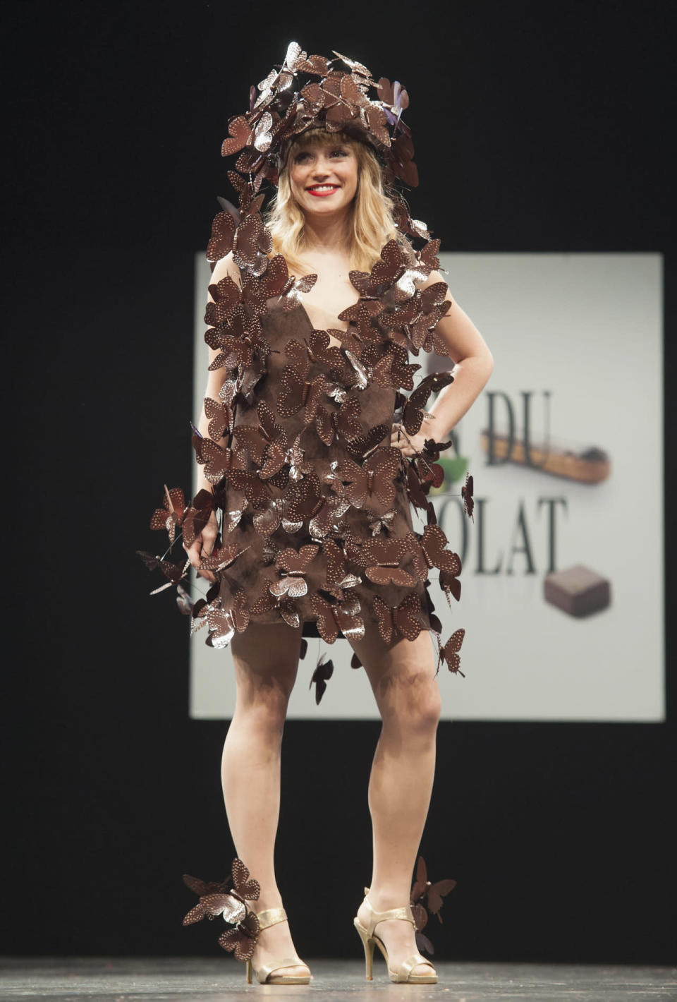 <p>Taking a cue from Alexander McQueen, this dress is composed of lots of chocolate butterflies from head to toe.</p>