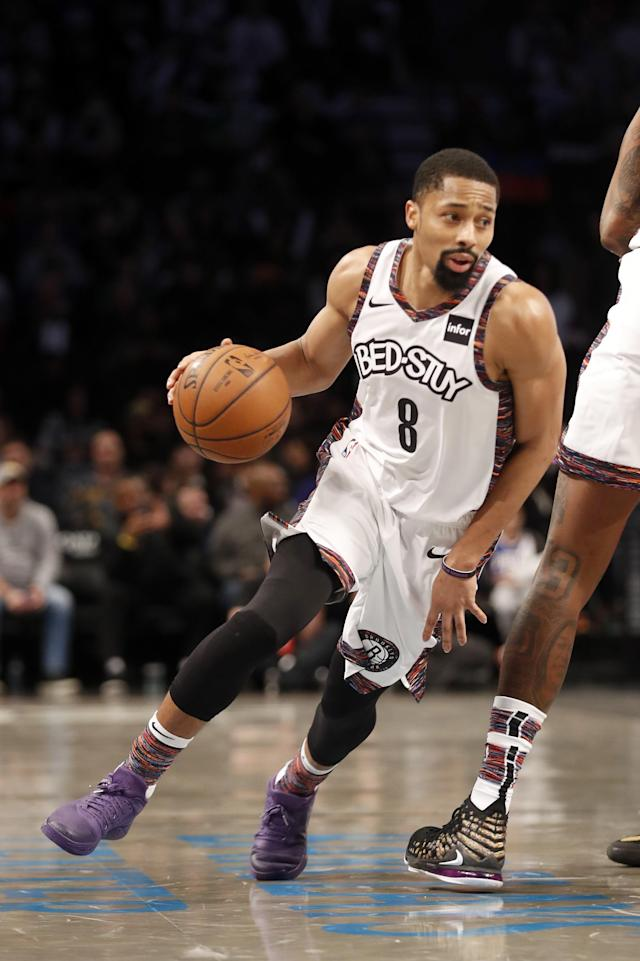 Brooklyn Nets guard Spencer Dinwiddie (8) drives to the basket during the first quarter of an NBA basketball game against the Philadelphia 76ers at Barclays Center, Sunday, Dec. 15, 2019, in New York. (AP Photo/Michael Owens)