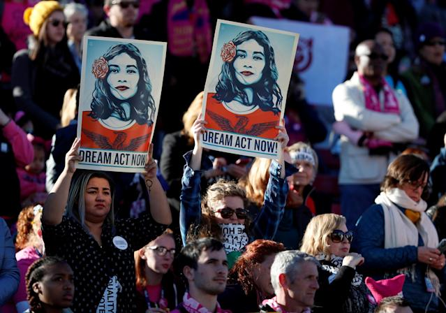 <p>Supporters of Deferred Action for Childhood Arrivals (DACA) hold signs during the Women's March rally in Las Vegas, Nev., Jan. 21, 2018. (Photo: Steve Marcus/Reuters) </p>