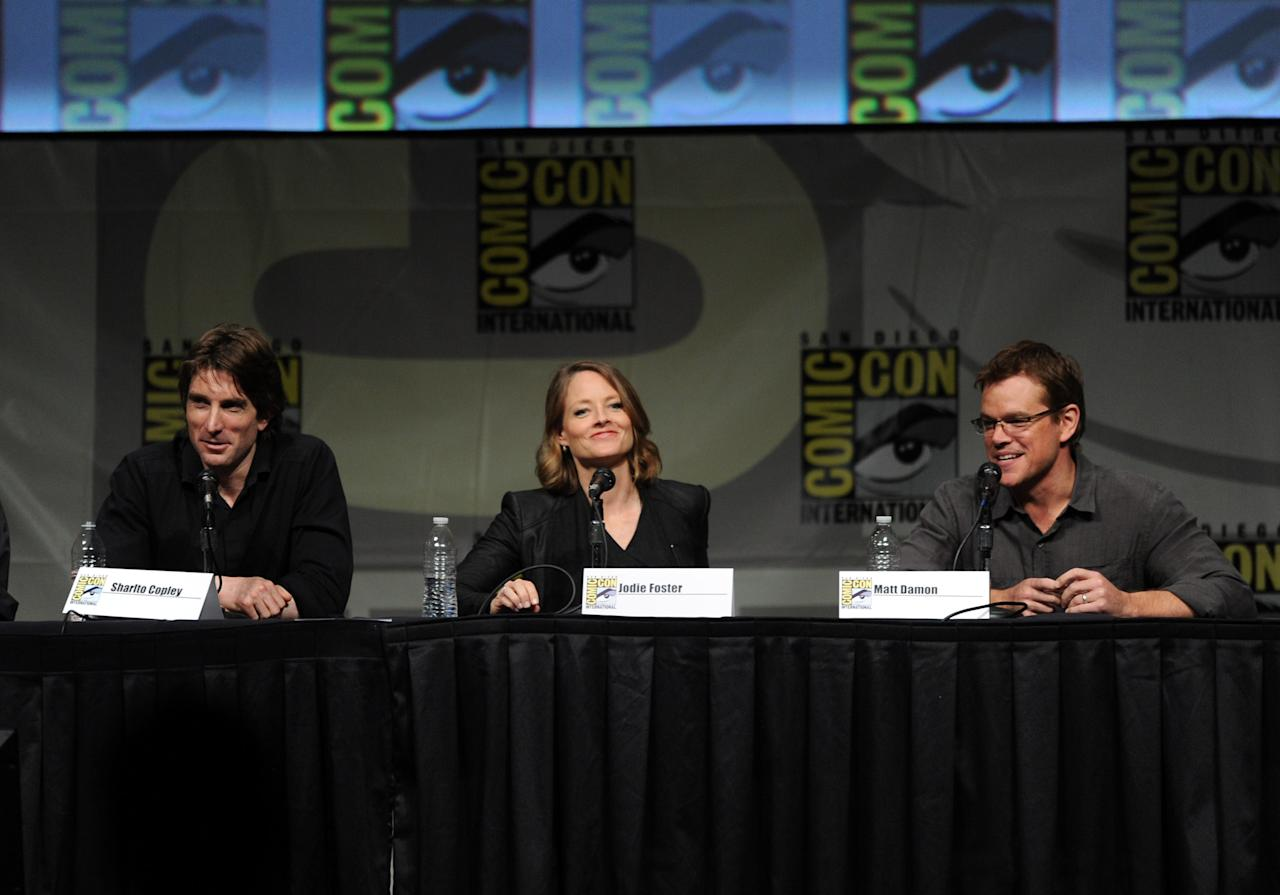 "SAN DIEGO, CA - JULY 13:  Actors Sharlto Copley, Jodie Foster, and actor Matt Damon speak during Sony's ""Eylsium"" panel during Comic-Con International 2012 at San Diego Convention Center on July 13, 2012 in San Diego, California.  (Photo by Kevin Winter/Getty Images)"
