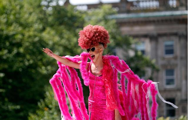 <p>A reveler reacts as the Pride parade makes its way through the city center, in Belfast, Northern Ireland, Saturday Aug. 5, 2017. (Photo: Peter Morrison/PA via AP) </p>