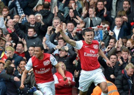 Arsenal's Dutch striker Robin van Persie (right) celebrates after scoring during the Premier League match against Norwich City at The Emirates Stadium in north London. Arsenal's bid for a top-four finish suffered a major setback as Steve Morison's late goal earned Norwich a deserved point in a six-goal thriller at the Emirates. The match ended 3-3