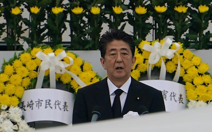 Japanese prime minister Shinzo Abe delivers a speech during a ceremony to mark the 75th anniversary of the bombing at the Hiroshima Peace Memorial Park on Thursday - AP Photo/Eugene Hoshiko