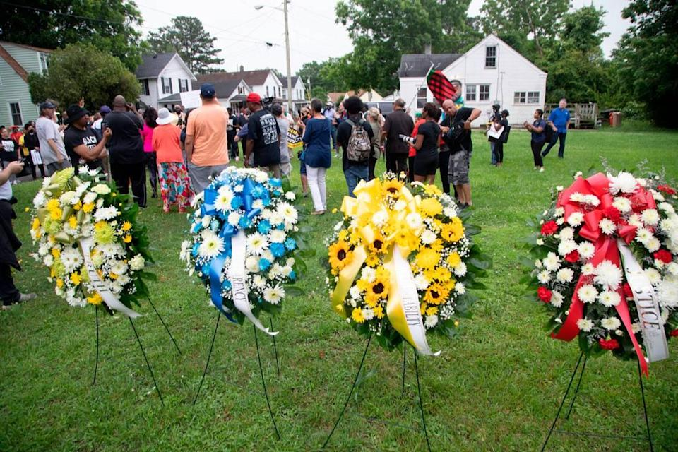 Demonstrators rally at the site where Andrew Brown Jr. was shot and killed by Pasquotank County Sheriff deputies while serving a warrant in April. Around 150 protesters called for a special prosecutor and the release of body-camera footage in the Brown.