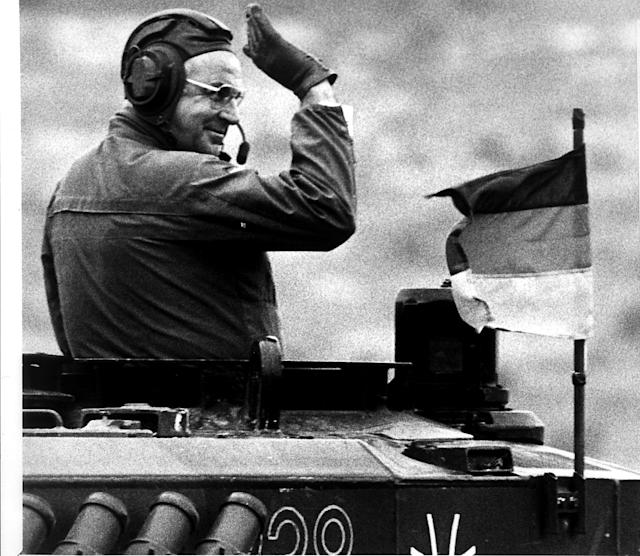 <p>Helmut Kohl waves from a Leopard tanks during a visit to German and British troops in Northern Germany, Setp. 17, 1986. (Michael Urban) </p>