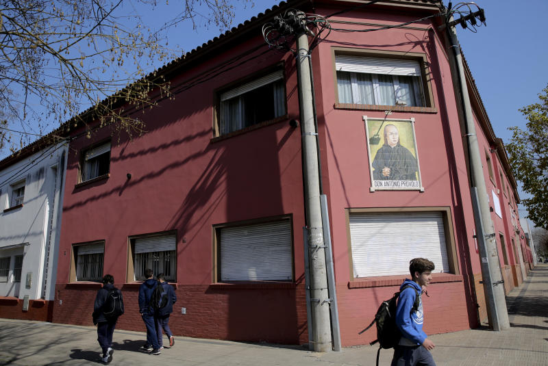 Children walk past the Antonio Provolo Institute in La Plata, Argentina, Thursday, Sept. 6, 2018. Authorities in Argentina carried out raids Thursday at a Catholic-run school for youths with hearing disabilities as part of an investigation into alleged sexual abuse of vulnerable children that has shocked the Pope Francis's homeland. (Santiago Hafford/La Nacion via AP) ARGENTINA OUT - NO PUBLICAR EN ARGENTINA