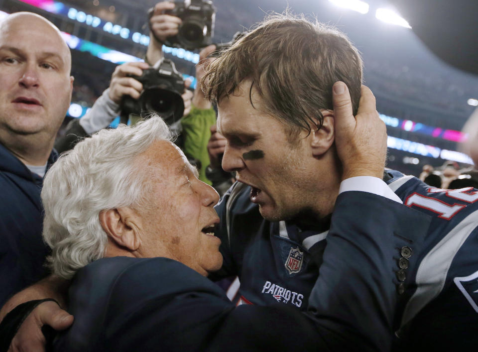 FILE - In this Jan. 21, 2018, file photo, New England Patriots owner Robert Kraft, left, embraces quarterback Tom Brady after defeating the Jacksonville Jaguars in the AFC championship NFL football game in Foxborough, Mass. Brady, the centerpiece of the New England Patriots championship dynasty over the past two decades, appears poised to leave the only football home he has ever had. The 42-year-old six-time Super Bowl winner posted Tuesday, March 17, 2020, on social media my football journey will take place elsewhere. The comments were the first to indicate the most-decorated player in NFL history would leave New England. (AP Photo/Winslow Townson, File)