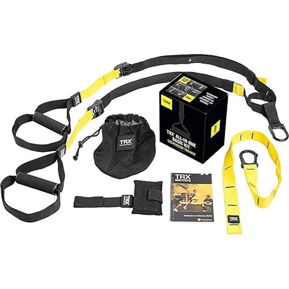 """<p><strong>TRX</strong></p><p>amazon.com</p><p><strong>$169.95</strong></p><p><a href=""""https://www.amazon.com/dp/B002YRB35I?tag=syn-yahoo-20&ascsubtag=%5Bartid%7C2139.g.19520579%5Bsrc%7Cyahoo-us"""" rel=""""nofollow noopener"""" target=""""_blank"""" data-ylk=""""slk:BUY IT HERE"""" class=""""link rapid-noclick-resp"""">BUY IT HERE</a></p><p>This all-inclusive package will allow dad to get a high-quality workout from the comfort of his own home. He can set this up in under a minute, and all he needs is a few square feet to work with. Whether he wants to build strength or increase his endurance, this training system will help him achieve his fitness goals. </p>"""