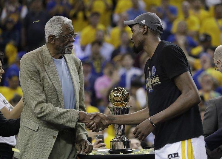 Bill Russell presents Kevin Durant with the Finals MVP award named in his honor. (AP)
