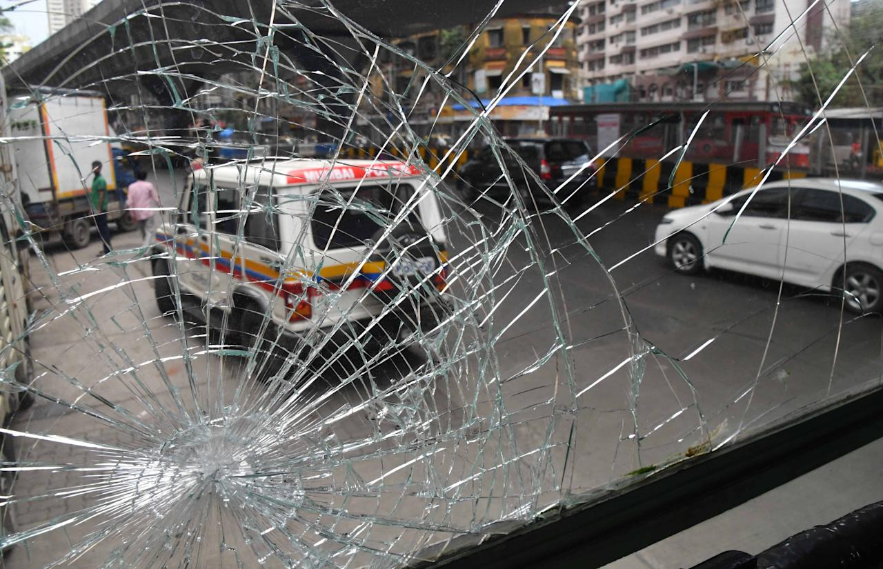 <p>Bus attacked by protestors at Lalbaug in Mumbai, India on Sept 10. Yahoo India/Stringer </p>