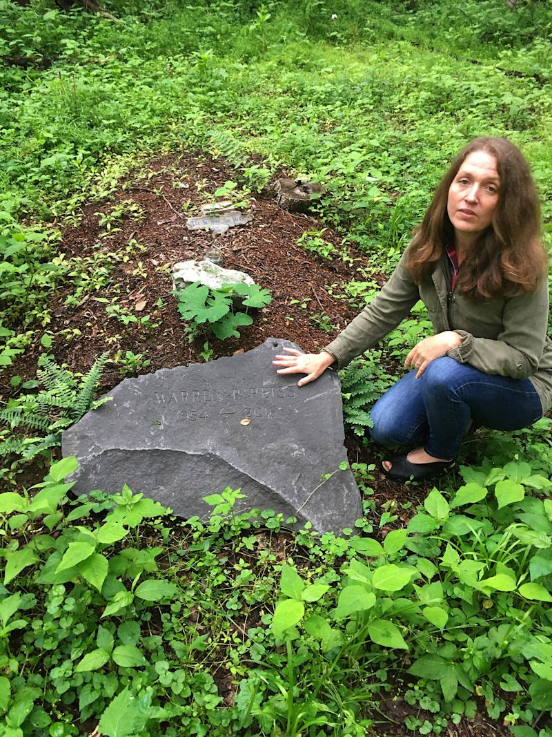 Green burials are on the rise. Town of Rhinebeck Cemetery committee chairwoman Suzanne Kelly points out a burial mound in the cemetery's natural burial ground in Rhinebeck, New York, located 80 miles north of New York City. (Photo: ASSOCIATED PRESS)