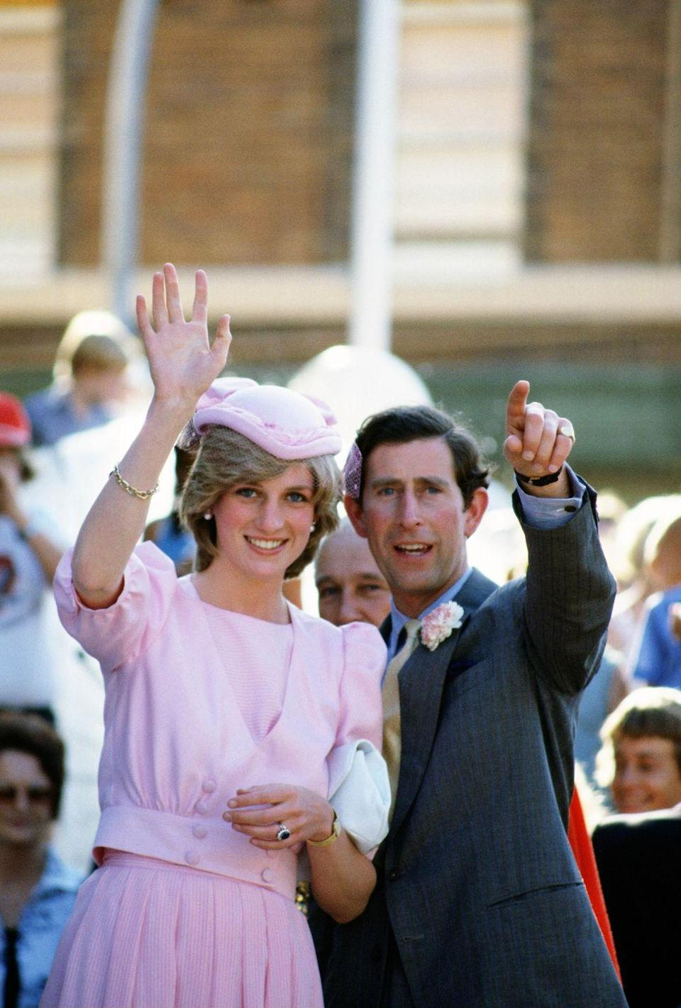 <p>Diana and Charles were greeted by huge crowds throughout their tour—and though <em>The Crown</em> made it seem like Charles was super jealous, he seems pretty chill here. Also plz note that his carnation perfectly matches Diana's dress. Cute.</p>