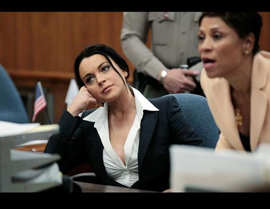 Actress Lindsay Lohan, left, is shown in court with her attorney Shawn Chapman Holley during a hearing in Beverly Hills, Calif. A judge refused Lohan's attorney's request to ease restrictions involving drug and alcohol testing on the actress so she could film a movie in Texas. A judge also ordered Lohan to wear an alcohol-monitoring bracelet on her ankle.