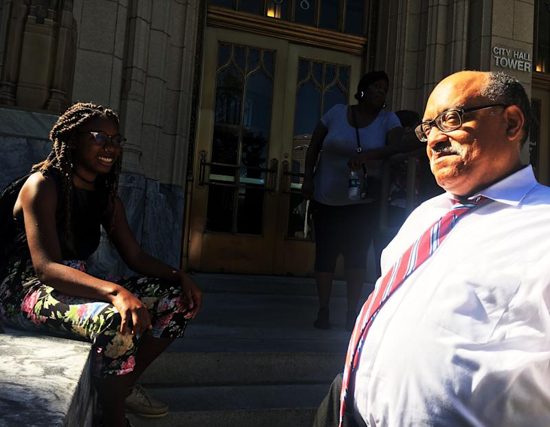 Fort speaks with Spelman College student Eva Dickerson, 20, outside Atlanta City Hall.