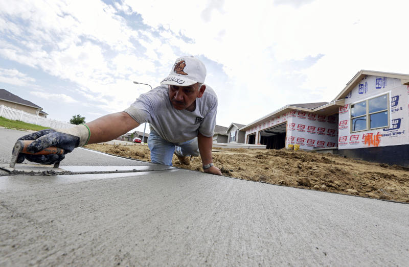 FILE - In this Thursday, Aug. 1, 2013, file photo, a sidewalk gets shaped in front of new construction in Omaha, Neb._The Commerce Department reports on new-home sales for August on Wednesday, Sept. 25, 2013. (AP Photo/Nati Harnik)