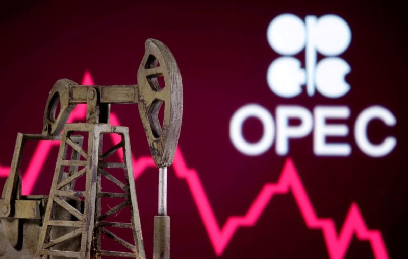 FILE PHOTO: A 3D printed oil pump jack is seen in front of displayed stock graph and Opec logo in this illustration picture