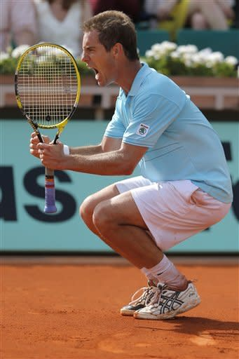 Richard Gasquet of France screams as he scores a point in his third round match against Tommy Haas of Germany at the French Open tennis tournament in Roland Garros stadium in Paris, Saturday June 2, 2012. (AP Photo/Bernat Armangue)