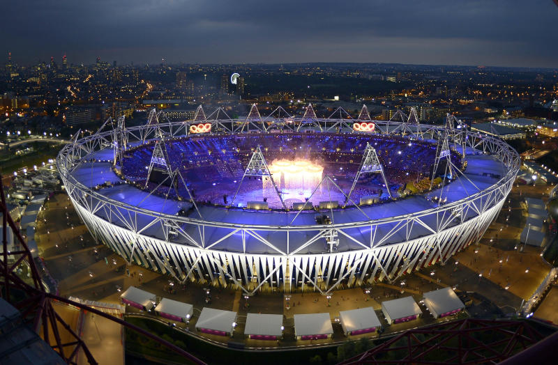 Smoke rises from the Olympic rings as they are suspended over the stadium during the Opening Ceremony at the 2012 Summer Olympics, Friday, July 27, 2012, in London. (AP Photo/Mark J. Terrill)