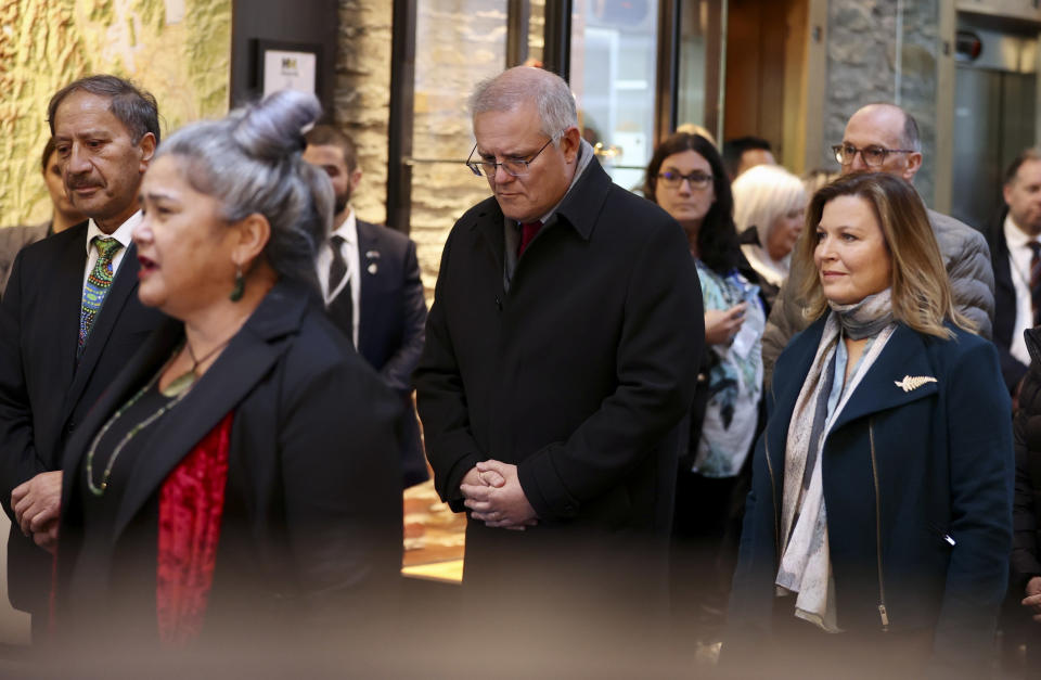Australian Prime Minister Scott Morrison, center, and his wife Jenny, right, attend a Powhiri (welcome ceremony) at a hotel in Queenstown, New Zealand, Sunday, May 30, 2021. Growing friction with China and how to reopen borders after the pandemic will likely be among the topics discussed by the leaders of Australia and New Zealand in their first face-to-face meeting since the coronavirus outbreak began. (George Heard/NZ Herald via AP)